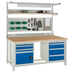 A fully kitted out beech workbench shown with above bench louvre panel and below bench cupboard and drawer combo.